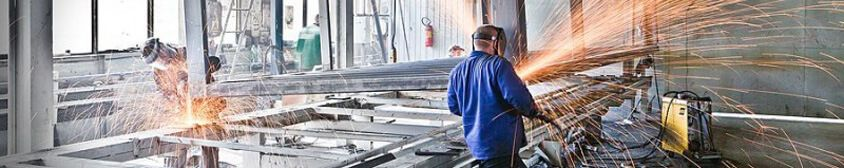 factory of prefabricated buildings : welding of the steel frames