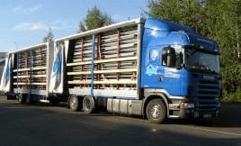 Transport of the flat container in kit form in a truck